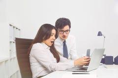 Shocked businesspeople smartphone Stock Image