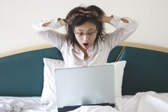 Shocked Businesswoman. In bed Stock Photography