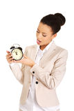 Shocked businesswoman with alarm clock. Stock Image