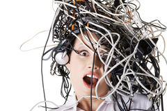Shocked businesswoman with cables on head. Troubled shocked businesswoman with cables on head Stock Image