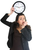 Shocked businesswoman with clock Royalty Free Stock Photo