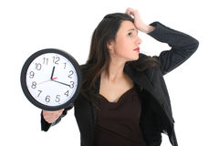 Shocked businesswoman with clock Royalty Free Stock Photos