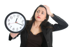 Shocked businesswoman with clock Royalty Free Stock Images