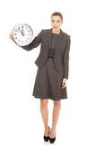 Shocked businesswoman with a clock. Royalty Free Stock Photography