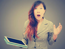 Shocked businesswoman with digital table Stock Photography