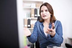 Shocked Businesswoman Facing Computer Screen stock photos