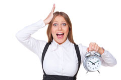 Shocked businesswoman holding alarm clock Stock Photo