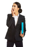 Shocked businesswoman holding a binder Royalty Free Stock Photo