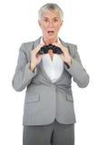 Shocked businesswoman holding binoculars Royalty Free Stock Image