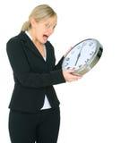 Shocked Businesswoman Look At Clock stock photos
