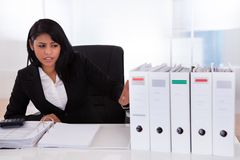 Shocked Businesswoman Looking At Folder. In Office Stock Photos