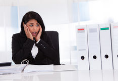 Shocked Businesswoman Looking At Folder. In Office Royalty Free Stock Images