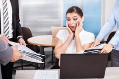 Shocked businesswoman looking at folders Royalty Free Stock Photography