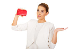 Shocked businesswoman looking into her empty wallet Royalty Free Stock Photo