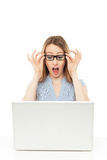 Shocked businesswoman looking at laptop Stock Photo