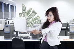 Shocked businesswoman looking money Stock Photos