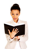Shocked businesswoman with a notebook. Stock Photos