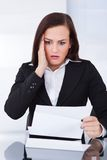 Shocked businesswoman reading document Stock Image