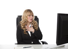 Shocked businesswoman reading her monitor Royalty Free Stock Image