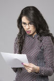 Shocked businesswoman reading a newspaper Royalty Free Stock Photo