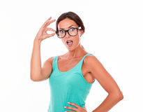 Shocked caucasian woman touching her glasses Stock Photos