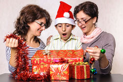 Shocked child boy looking in Christmas present box Stock Image