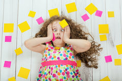 Shocked child with empty stickers on his body. Stress from studying, doing homework.  Children education concept Royalty Free Stock Images