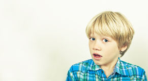 Shocked child. Young boy with a shocked look Stock Photography