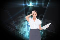 Shocked classy businesswoman holding newspaper Royalty Free Stock Photos