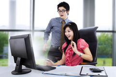 Shocked couple in front of computer Stock Photo