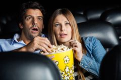 Shocked Couple Watching Movie In Theater Royalty Free Stock Photos