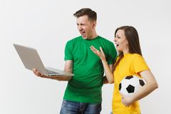 Shocked couple woman man, football fans in yellow green t-shirt cheer up support team with soccer ball, watching game on stock photography