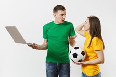 Shocked couple woman man, football fans in yellow green t-shirt cheer up support team with soccer ball, watching game on stock photos