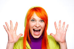 Shocked crazy screaming woman with red hair. Hands up Stock Image