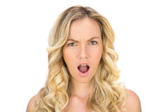 Shocked curly haired blonde posing Royalty Free Stock Photos