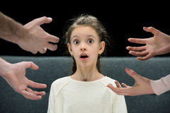 Shocked daughter with parents near by, divorce concept Stock Photo