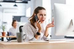 Shocked disappointed young businesswom stock image
