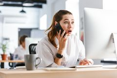 Shocked disappointed young businesswom stock photo
