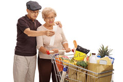 Shocked elderly couple looking at a store receipt Royalty Free Stock Images