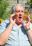 Shocked elderly man closeup. stock images
