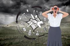 Shocked elegant businesswoman looking through binoculars Stock Photo