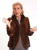 Shocked elegant mature lady. Portrait of a shocked elegant senior lady in a mink coat Stock Photos