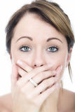 Shocked Embarrassed Young Woman with Hands Covering her Mouth Stock Photography