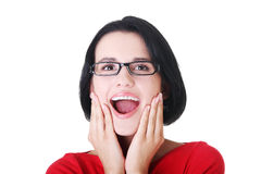 Shocked and excited woman looking up Stock Images