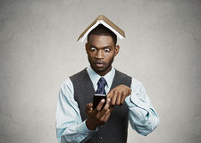 Shocked executive man reading breaking news on smart phone Royalty Free Stock Photo