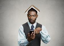 Shocked executive man reading breaking news on smart phone royalty free stock photo