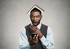 Shocked executive man reading breaking news on smart phone Stock Image