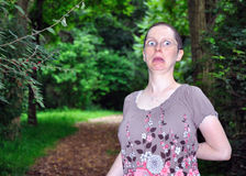 Shocked Expression. A woman in a forest setting has a shocked expression on her face Royalty Free Stock Image