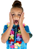 Shocked expression from cute girl wearing a lei Royalty Free Stock Photo