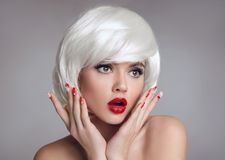 Shocked face. Blond Woman with red lips and manicure nails surpr Stock Images